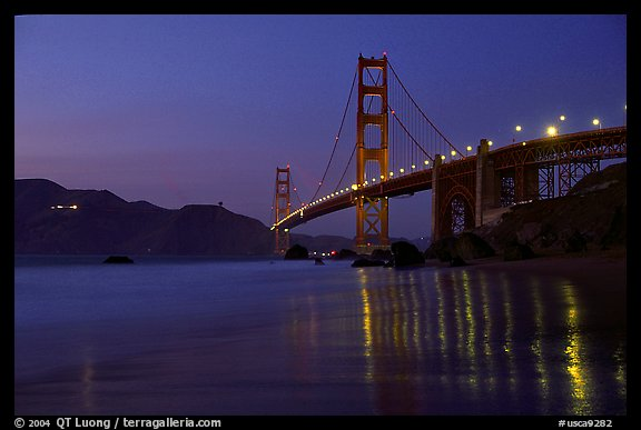 Golden Gate bridge and surf with light reflections, seen from E Baker Beach, dusk. San Francisco, California, USA (color)