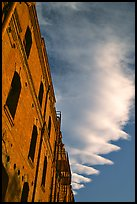Old brick building and serrated cloud, sunset, Fisherman's Wharf. San Francisco, California, USA (color)