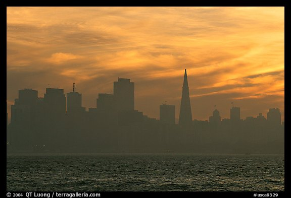 City skyline with sunset clouds seen from Treasure Island. San Francisco, California, USA (color)