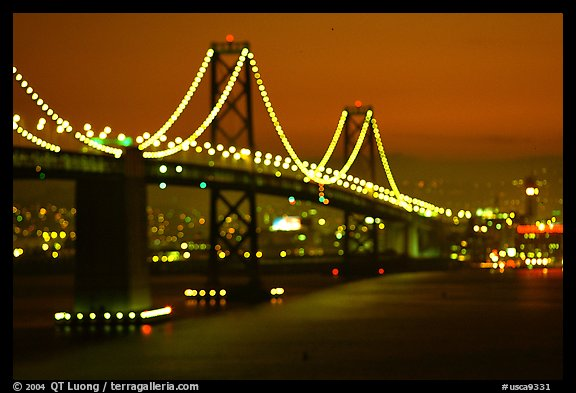 Bay Bridge seen from Treasure Island with defocused lights, sunset. San Francisco, California, USA (color)