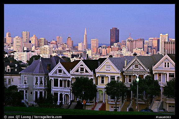 Victorians at Alamo Square and skyline, dusk. San Francisco, California, USA (color)