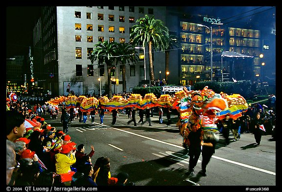 Dragon dancing during the Chinese New Year celebration, Union Square. San Francisco, California, USA (color)