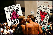 Gay couple with signs during the Gay Parade. San Francisco, California, USA ( color)