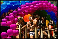 Men with rainbowed ballons on a float during the Gay Parade. San Francisco, California, USA (color)