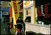 Hispanic women at a taco shop. Redwood City,  California, USA (color)