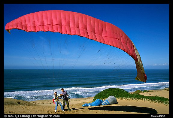 Paragliders practising in sand dunes, Marina. California, USA