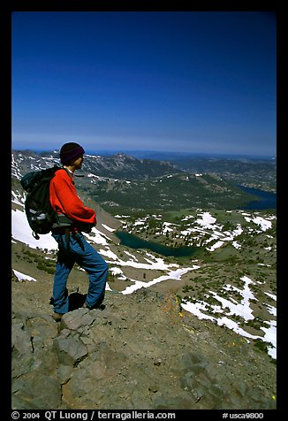 Hiker standing on top of Round Top Mountain. Mokelumne Wilderness, Eldorado National Forest, California, USA (color)