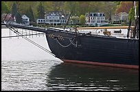 LA Dunton schooner and houses across the Mystic River. Mystic, Connecticut, USA (color)