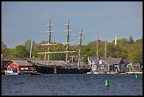 Three masted ship, Mystic River, and church. Mystic, Connecticut, USA (color)