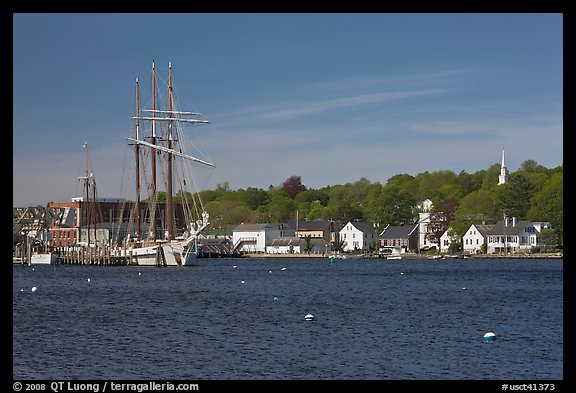 Ship, houses, and church across the Mystic River. Mystic, Connecticut, USA (color)