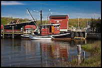Boats and reflections at shipyard. Mystic, Connecticut, USA (color)