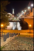 Quay by Connecticut River and nighttime skyline. Hartford, Connecticut, USA