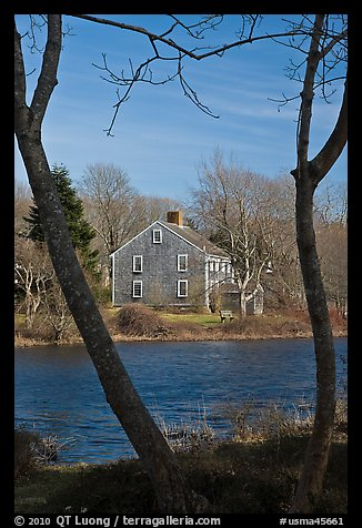 Historic house next to pond, Sandwich. Cape Cod, Massachussets, USA (color)