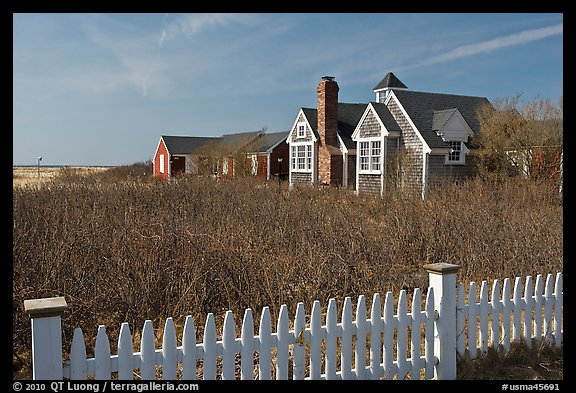 Fence and cottages in winter, Truro. Cape Cod, Massachussets, USA (color)