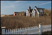 Fence and cottages in winter, Truro. Cape Cod, Massachussets, USA ( color)