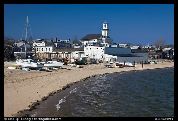 Yachts on beach and church, Provincetown. Cape Cod, Massachussets, USA