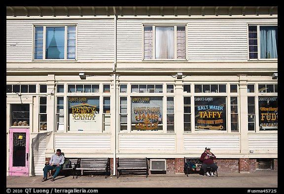 Men sitting in front of candy store, Provincetown. Cape Cod, Massachussets, USA (color)