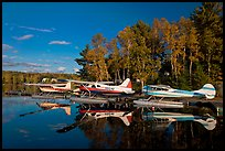 Floatplanes and reflections in Moosehead Lake  late afternoon, Greenville. Maine, USA ( color)