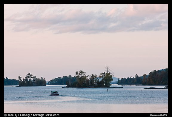 Motorboat and islets at sunset,  Moosehead Lake, Greenville. Maine, USA (color)