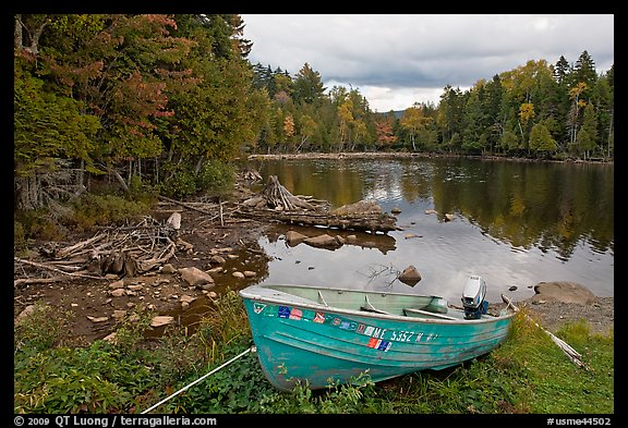 Cove and boat on shore of  Moosehead lake, Lily Bay State Park. Maine, USA (color)