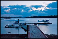 Seaplanes and dock at dusk, Ambajejus Lake. Maine, USA (color)