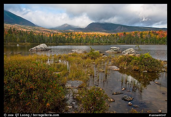 Mountains with fall colors rising above pond. Baxter State Park, Maine, USA (color)