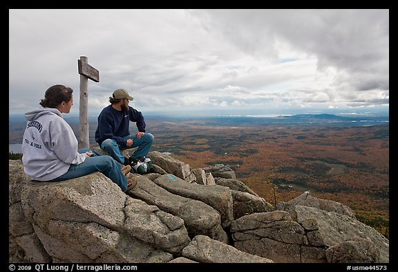 Hikers taking in view near sign marking summit of South Turner Mountain. Baxter State Park, Maine, USA (color)
