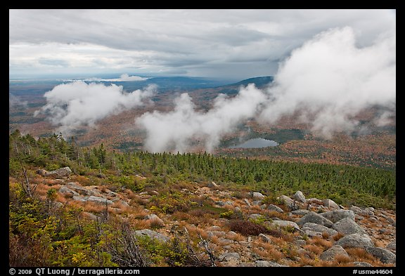 Autumn landscape with clouds hovering below mountains. Baxter State Park, Maine, USA (color)