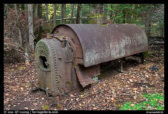 Steam engine remnant in forest. Allagash Wilderness Waterway, Maine, USA (color)