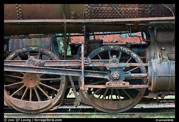 Wheels and pistons of vintage locomotive. Allagash Wilderness Waterway, Maine, USA (color)
