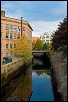 Kenduskeag stream flows dowtown. Bangor, Maine, USA