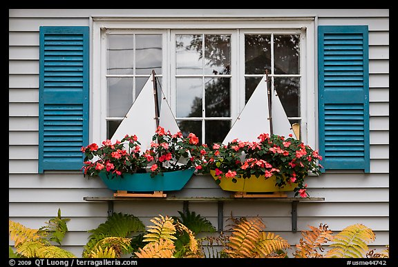 Window with flower pots shaped like sailboats. Bar Harbor, Maine, USA (color)