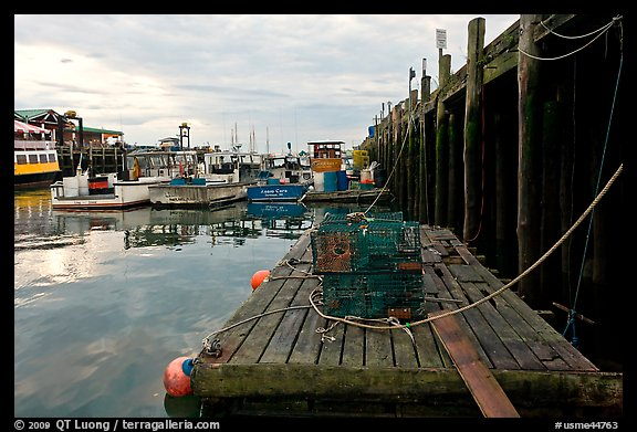 Lobster traps and fishing boats below pier. Portland, Maine, USA