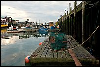 Lobster traps and fishing boats below pier. Portland, Maine, USA ( color)