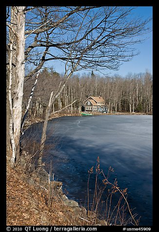 House by frozen lake. Maine, USA (color)