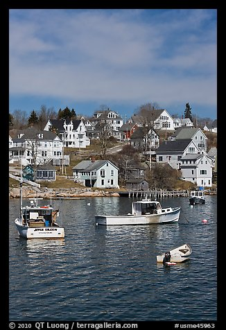 Lobster boats and houses on hillside. Stonington, Maine, USA (color)
