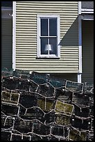 Lobster traps and window. Stonington, Maine, USA ( color)