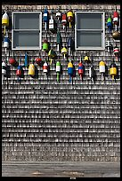 Facade decorated with buoys. Maine, USA ( color)