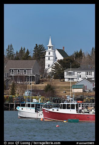 Lobster boats and village church. Corea, Maine, USA (color)