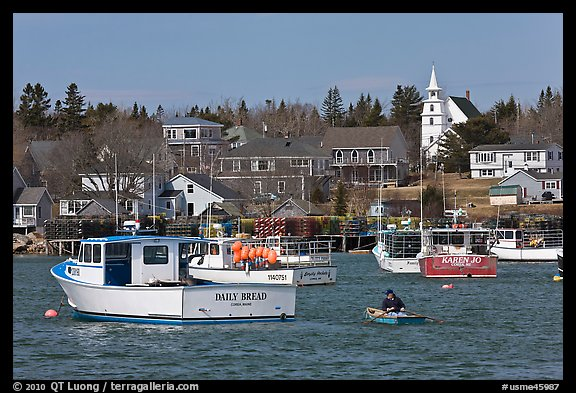 Lobsterman paddling towards boat. Corea, Maine, USA (color)