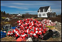 Buoys and house. Corea, Maine, USA (color)
