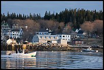 Men on small boat in harbor. Stonington, Maine, USA ( color)