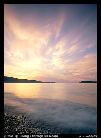 Clouds, surf, and islands near Grand Portage, sunrise. USA (color)