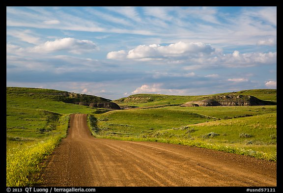 Gravel road, rolling hills and badlands. North Dakota, USA (color)