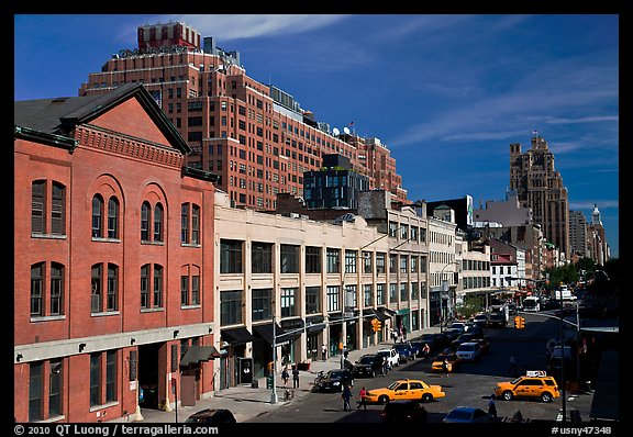 Taxi cars in streets and brick buildings. NYC, New York, USA (color)