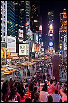 One Times Square at night and Francis Duffy monument. NYC, New York, USA (color)