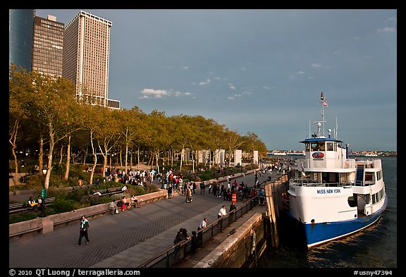 Tour boat along Battery Park, evening. NYC, New York, USA (color)