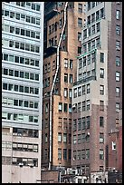 Old high-rise buildings with exterior pipe. NYC, New York, USA ( color)