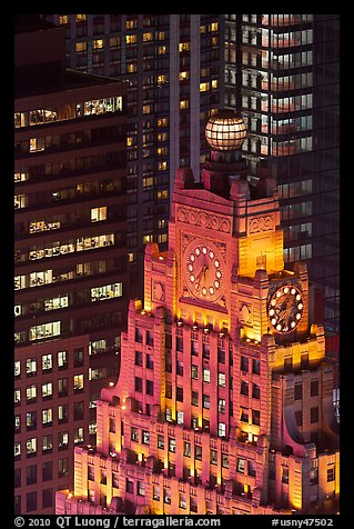 Top of vintage high-rise building with globe and clocks. NYC, New York, USA (color)