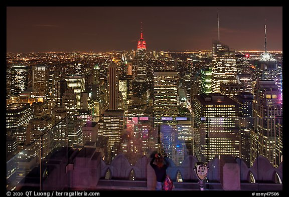 Woman on observation platform of Rockefeller center at night. NYC, New York, USA (color)